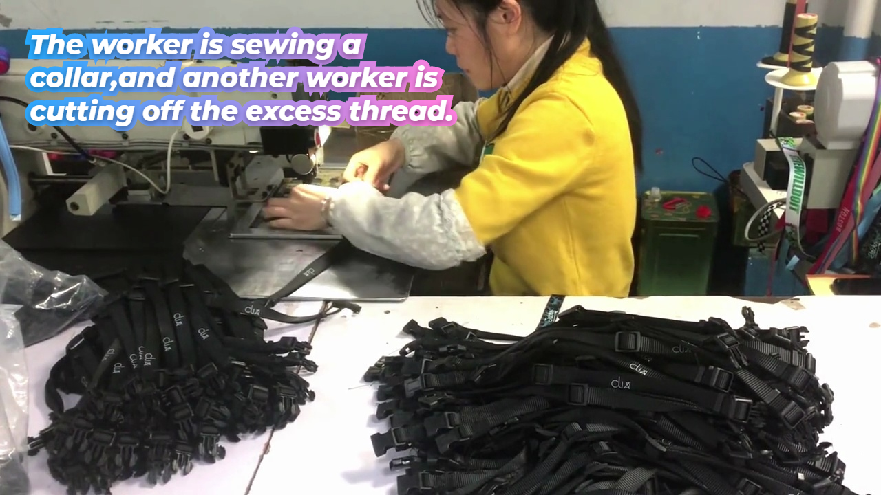 The worker is sewing a collar,and another worker is cutting off the excess thread.