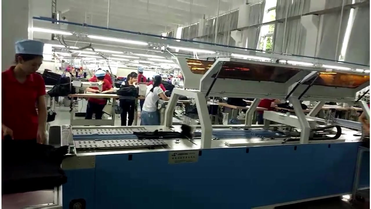 Auto clothes packing production line